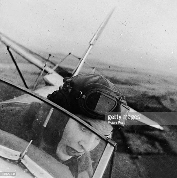 The British actress Valerie Hobson in a Tiger Moth aeroplane during a flying lesson Original Publication Picture Post 4490 Valerie Hobson Learns to...
