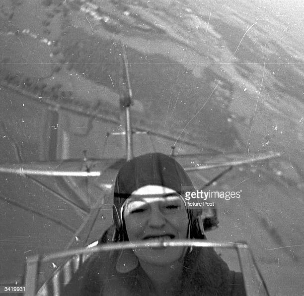 The British actress Valerie Hobson in a Tiger Moth aeroplane during a flying lesson. Original Publication: Picture Post - 4490 - Valerie Hobson...