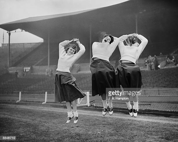 Three US cheerleaders at the final of the United States Air Forces in Europe Football Championships played at Wembley