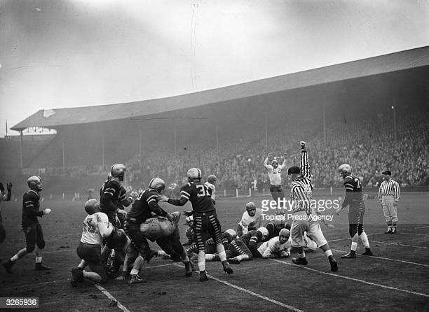 US Air Forces from England and Germany play one another at Wembley Stadium The Fuerstenfeldbruck Eagles are seen gaining a touchdown against the...