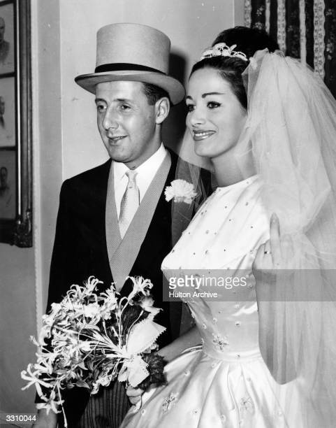 Actress Jackie Collins on her wedding day alongside her husband Austin Wallace