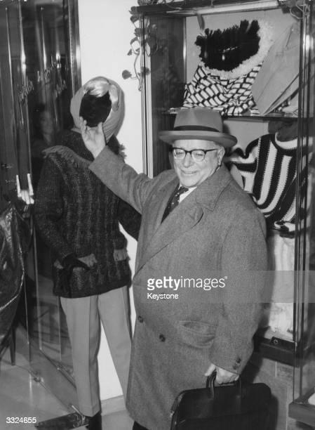 Palmiro Togliatti leader of the Italian Communist Party shopping for Christmas in Rome
