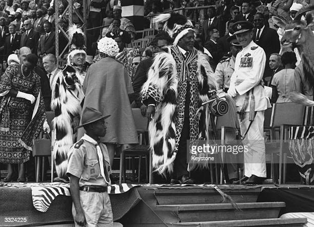 Kenya's first prime minister Jomo Kenyatta wearing colobus skins at the ceremony in Nairobi's Uhuru Stadium to proclaim Kenyan independence after 68...