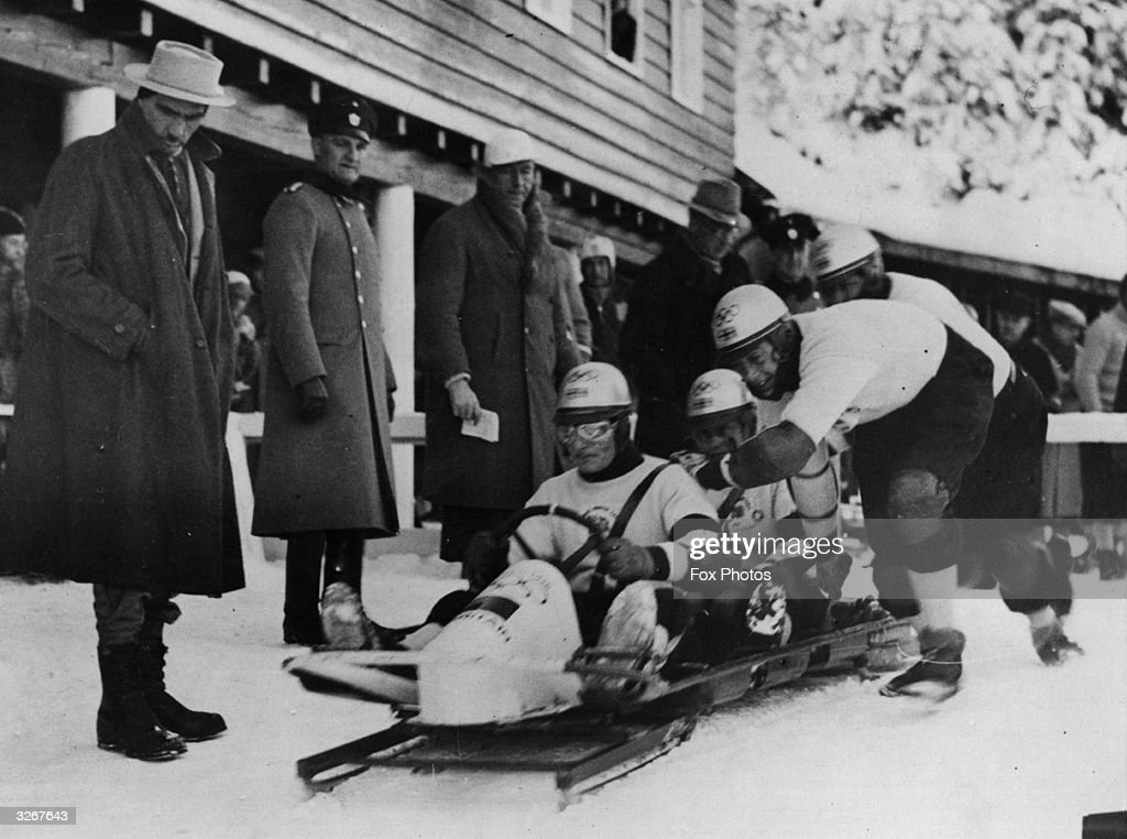 The British four-man bobsleigh team starts off in one of the runs at the winter Olympic Games at Garmisch-Partenkirchen, where they won a bronze medal. Frederick McEvoy, James Cardno, Guy Dugdale and Charles Green.