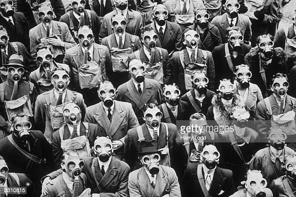 Some of London's telephone operators and engineers trying out their gas masks at the antigas civilian training centre in Gloucester where they were...