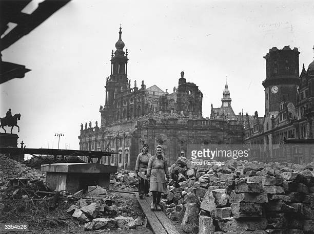 Women workers removing debris from the shell of the Hof Kirche the Catholic cathedral in Dresden Germany