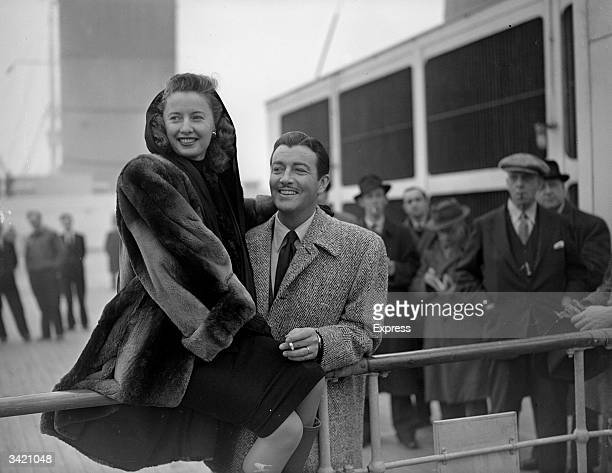 Married American actors Barbara Stanwyck and Robert Taylor on board a ship