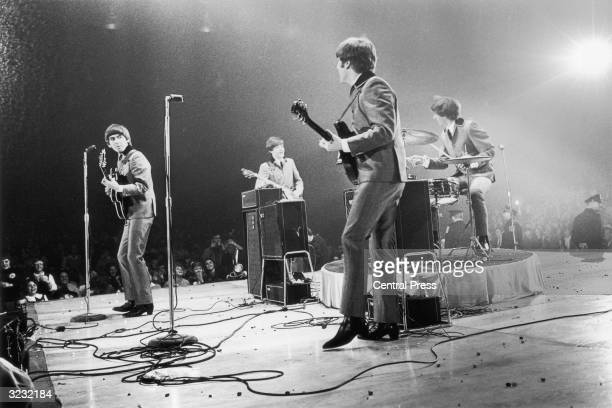 The Beatles in performance at the Washington Coliseum Left to right George Harrison Paul McCartney John Lennon and Ringo Starr