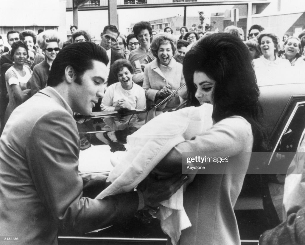 Elvis and Priscilla Presley with their daughter, Lisa Marie, born on 2nd February.