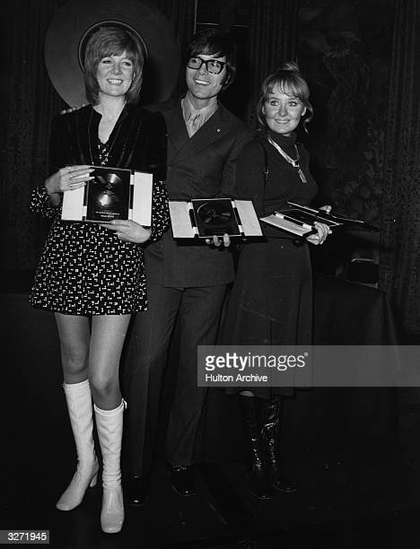 Cilla Black Cliff Richard and Lulu holding their awards at the 'Disc and Music Echo' Valentine Awards ceremony at the Cafe Royal in London where...