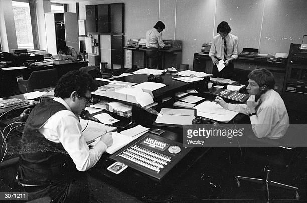 Office workers in the Foreign Exchange Department at American Express.