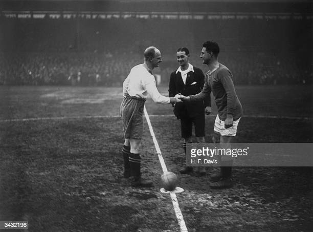 The captains of Chelsea and Everton shaking hands before the start of a cup tie at Chelsea's ground Stamford Bridge