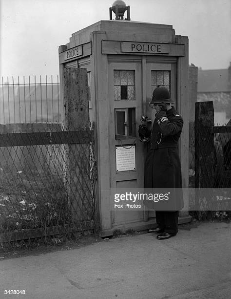 A metropolitan police emergency telephone box for public use at Richmond in London