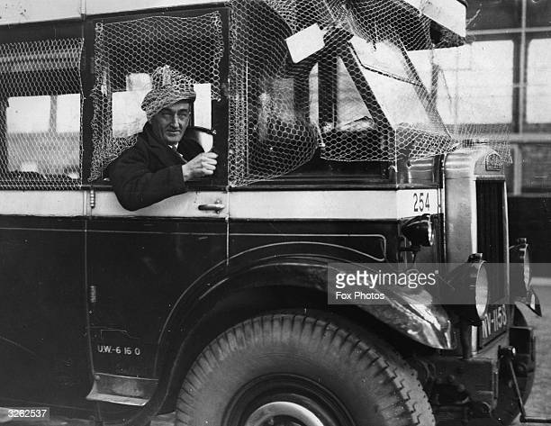 Portrait of the voluntary driver Mr Burnett on the Kettering to Rushden route protected from attack by netting around his driving cabin He replaces...