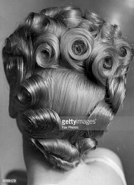 Hairstyle created for debutantes when they are presented at court. The coiffure is designed to leave space for the plumes which are clipped into the...