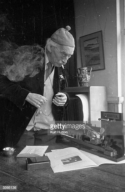 86 year old Tobias Matthay examines a model of a piano keyboard Original Publication Picture Post 1870 Tobias Matthay Music Master pub 1945