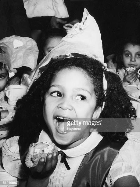 13th January 1950 Fiveyearold Sandra Sides enjoys a slice of cake at a party for black children at Whitechapel in London's East End The party was...