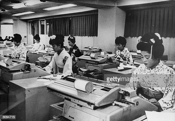 Tokyo bank staff are wearing traditional kimonos during the Tokyo Olympics.
