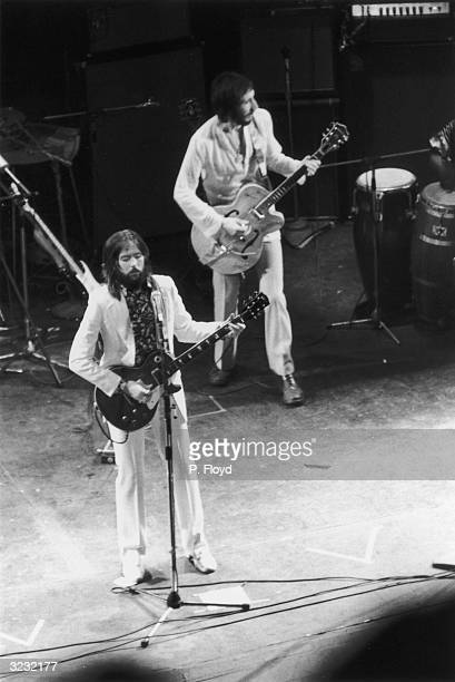 Rock guitarists, Pete Townshend of The Who, and Eric Clapton performing at the Rainbow Theatre in London.
