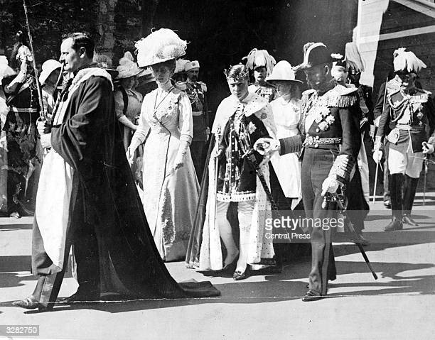 The Duke of Windsor between his mother Queen Mary and father King George V at his investiture as Prince of Wales at Carnarvon Castle He succeeded his...