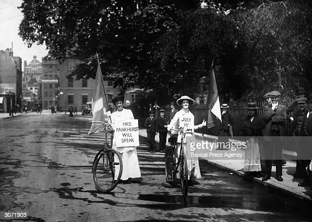 Two suffragettes advertising a meeting at which Emmeline Pankhurst will speak