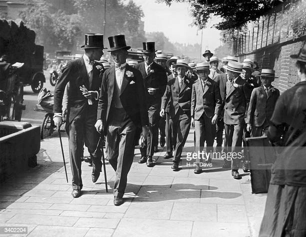 A group of Eton and Harrow schoolboys arriving for the cricket match between the two schools at Lord's cricket ground London
