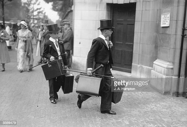 Tophatted schoolboys arriving at Lord's for an Eton versus Harrow cricket match