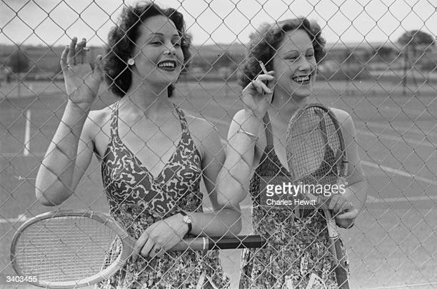 A couple of young holiday makers enjoying themselves on the tennis courts at a Butlin's holiday camp Original Publication Picture Post 4136 Life In A...