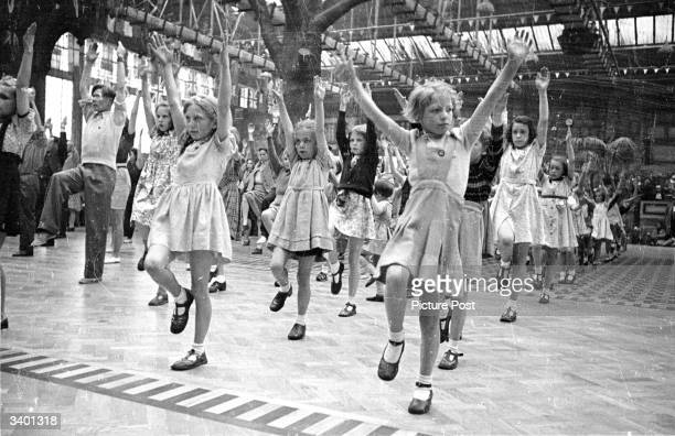 A group of children being entertained by the staff in the Butlin's Camp at the North Yorkshire seaside resort of Filey Original Publication Picture...