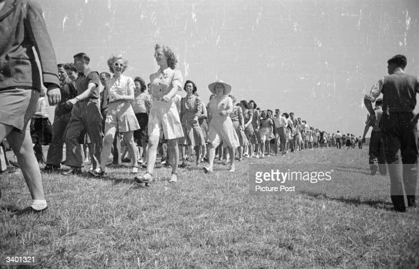 A group of holidaymakers in the Butlin's Camp at the North Yorkshire seaside resort of Filey set out for a ramble Original Publication Picture Post...