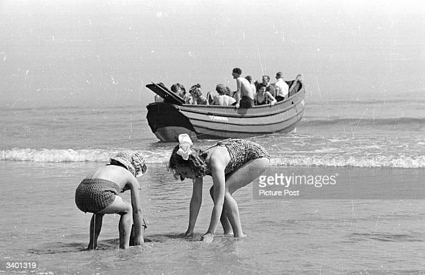 Group of holidaymakers on the beach near the Butlin's Camp at the North Yorkshire seaside resort of Filey. Original Publication: Picture Post - 4136...