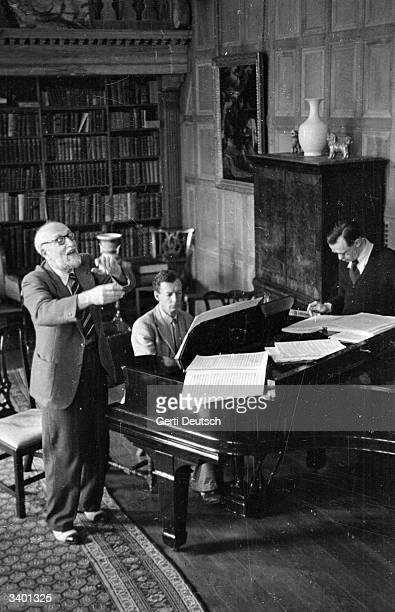Swiss conductor Ernest Ansermet takes singers Flora Nielsen and Nancy Evans through a rehearsal of Benjamin Britten's 'The Rape of Lucretia' for the...