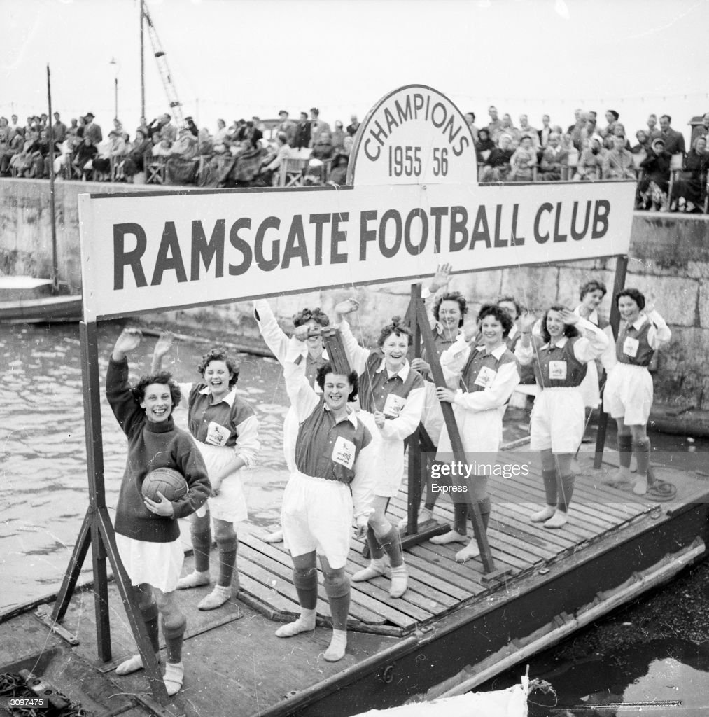 Members of Ramsgate's womens football team celebrate winning the championship down at the harbour.