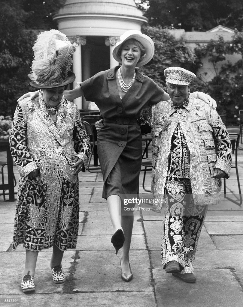 English actress Margaret Leighton with Beck and Bert Williams, pearly king and queen of Hampstead, doing the Lambeth Walk at a garden party in aid of Sunshine Homes for blind babies and children in Regent's Park, London.