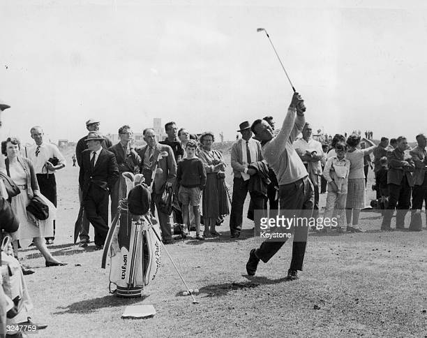 American golfer Arnold Palmer takes a practise swing before the British Open Golf Championships at Royal Birkdale