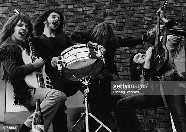 British rock group Humble Pie larking about From left to right Peter Frampton Jerry Shirley Gregg Ridley and Steve Marriott