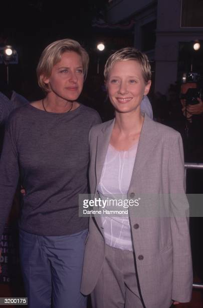 Ellen Degeneres and Anne Heche posing together at the premiere for the film Eyes Wide Shut, Mann's Village Theater, Los Angeles, California.