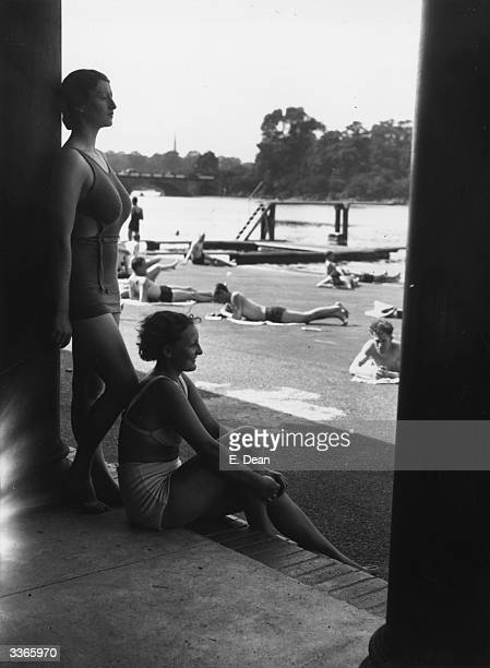 Bathers resting in the shade after swimming at the Lido in Hyde Park London