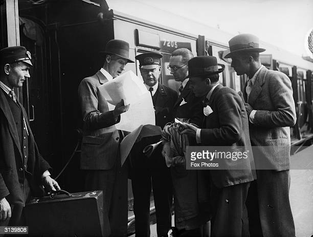 Mr F W Thistleton trying to persuade railway staff at Waterloo to add their names to a 100,000 strong petition appealing to the Home Secretary to...