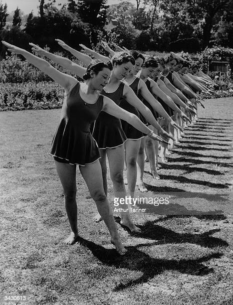 Members of the Northampton Ladies Physical Culture Club exercising.