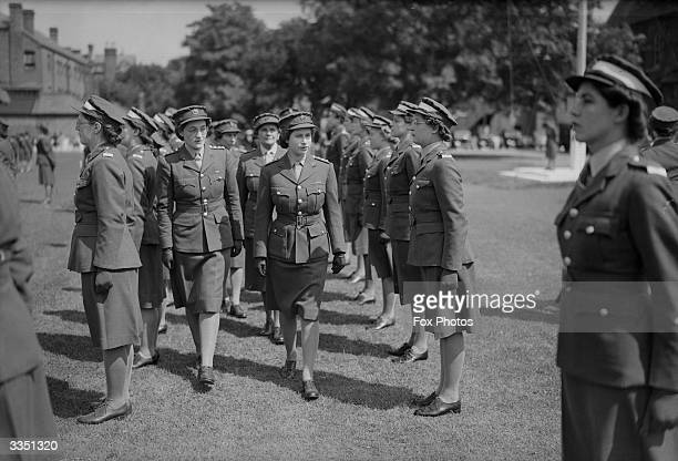 Princess Elizabeth inspecting ATS cadets at a passing out parade at Imperial Services College, Windsor, England.