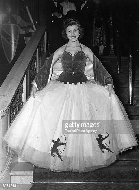 Joan Rice the British leading lady who was formerly a waitress is at the Empire cinema for the premiere of 'Ivanhoe'. She is wearing a white and...