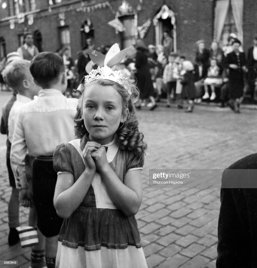 A young girl with a homemade tiara, at a street party at Morpeth Street, in London's East End, to celebrate the coronation of Queen Elizabeth II. Original Publication: Picture Post - 6542 - Cockneys' Own Party - pub. 1953