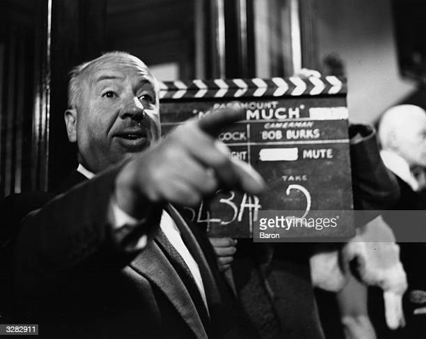 Film director and auteur Alfred Hitchcock filming 'The Man Who Knew Too Much' a Paramount remake of his 1934 spy thriller