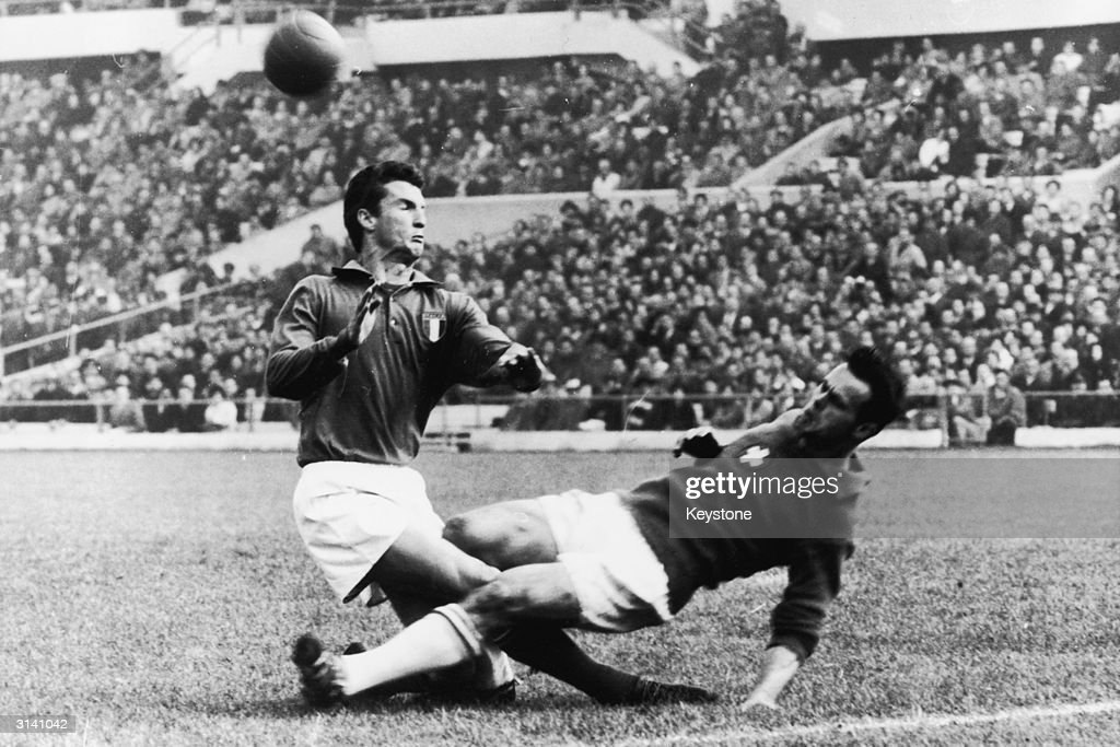 Italian footballer Angelo Sormani collides with a Swiss player, Heinz Schneiter, during a World Cup game.