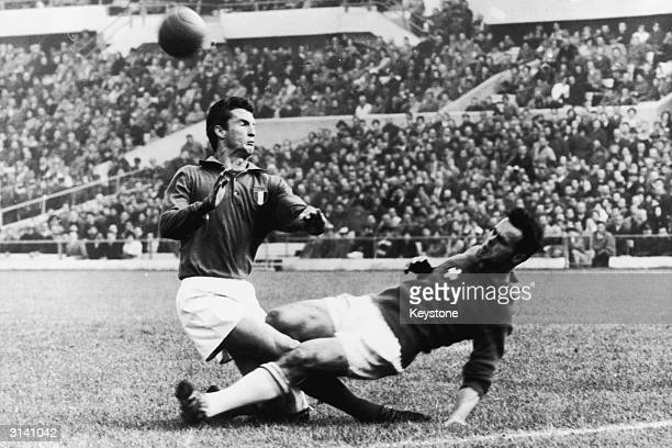 Italian footballer Angelo Sormani collides with a Swiss player Heinz Schneiter during a World Cup game