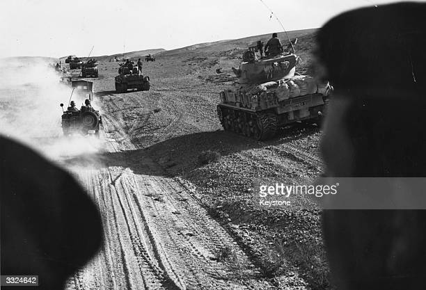 Israeli forces advancing in tanks in the Sinai Desert to attack the Egyptian Army during the Six Day War