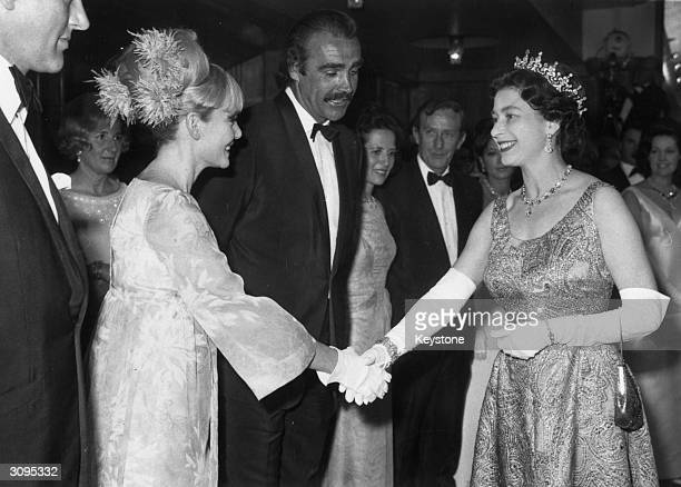 Scottish film star Sean Connery and his wife Diane Cilento welcome the Queen to the premiere of Sean's latest Bond film 'You Only Live Twice' at the...