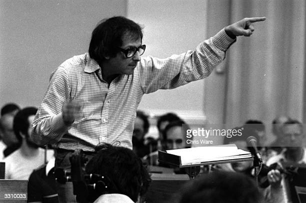 Principal Conductor Andre Previn conducts the London Symphony Orchestra in the 75th Anniversary Concert at the Festival Hall seen here during...