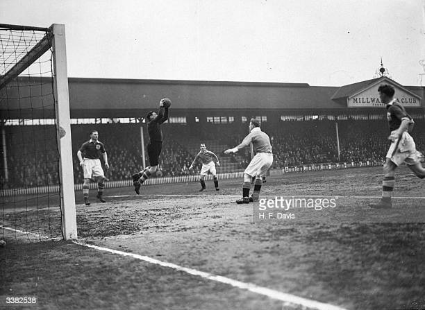 Millwall goalkeeper Tuill gathers the ball as Millwall play Manchester City at The Den
